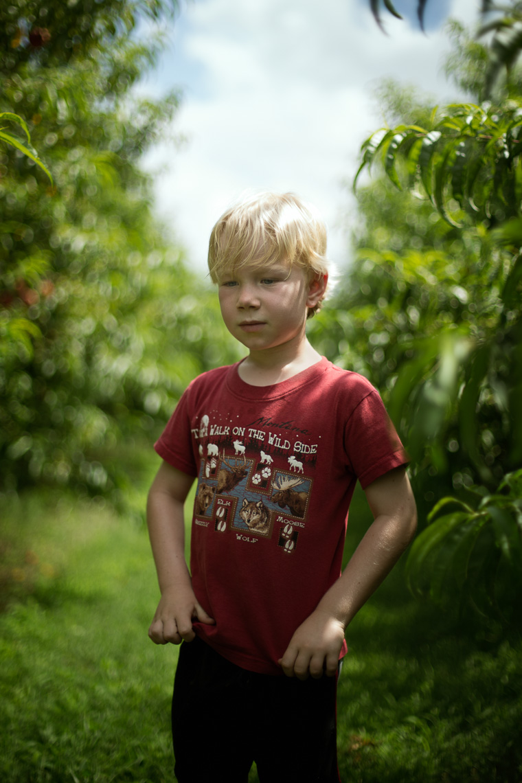 Boy with peaches
